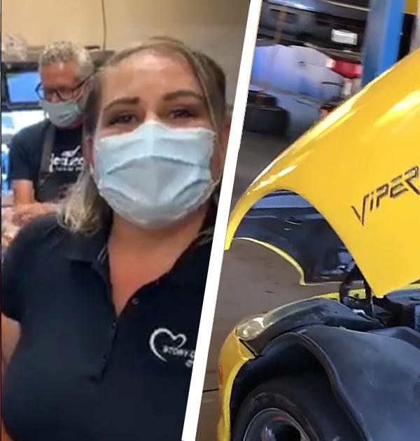 man and woman wearing masks next to a viper car
