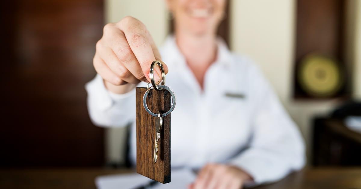 Hotel concierge handing a hotel key