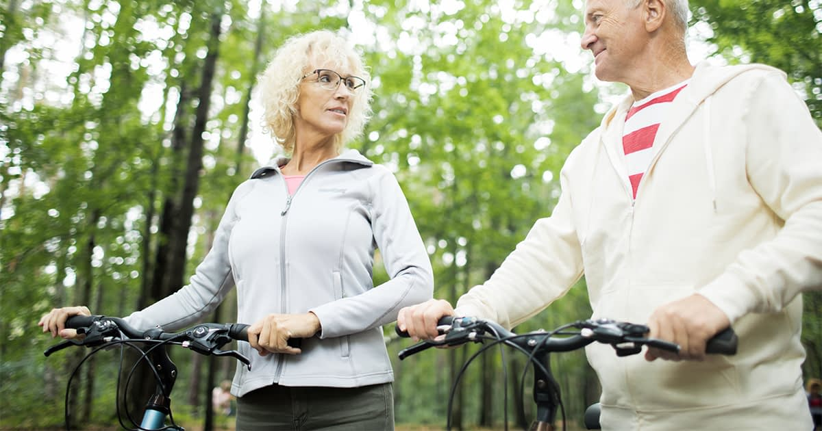 a senior couple riding bicycles