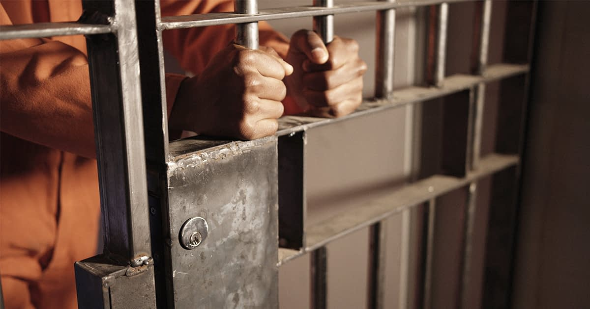 Man behind jail bars