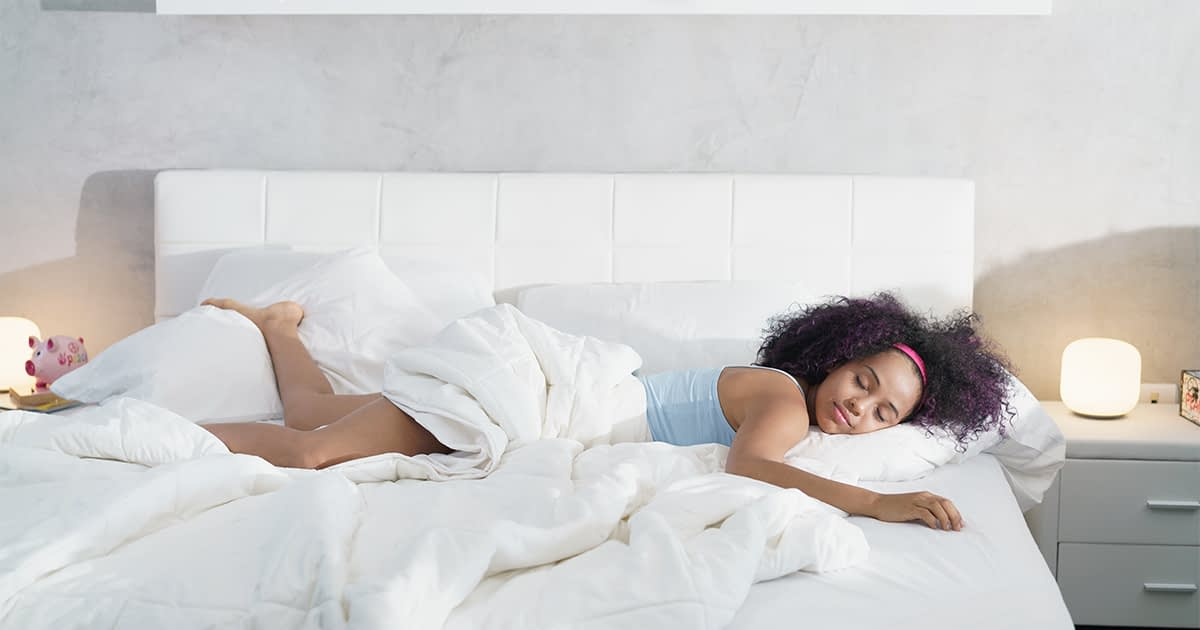 African American woman sleeping alone in a bed