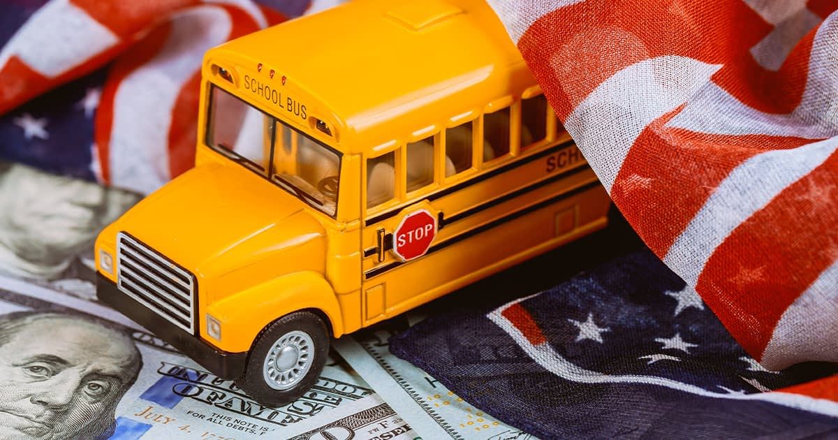 american money with a school bus and a flag