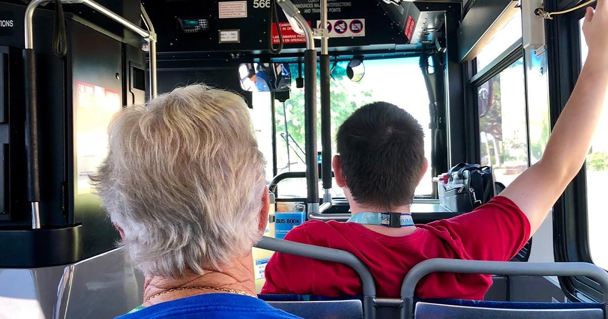 two men inside a city bus